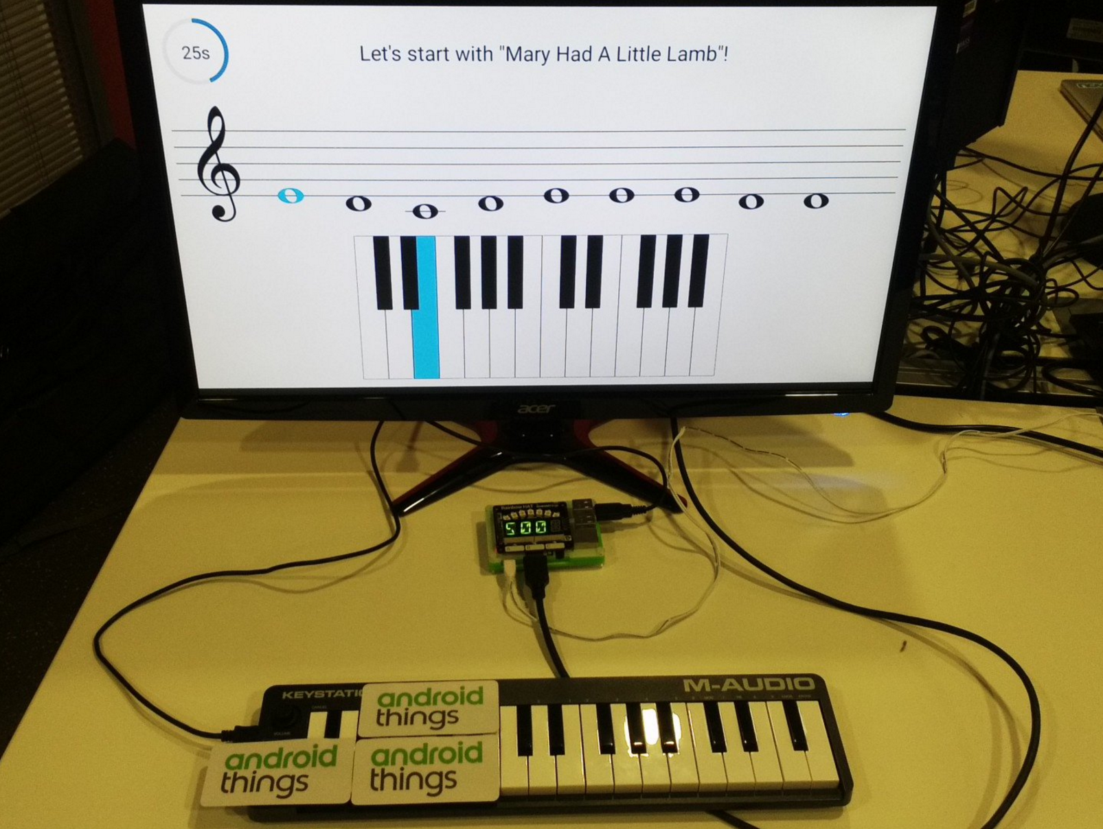 piano hero: a physical piano connected to a Raspberry Pi device connected to a TV showing some music notes on screen